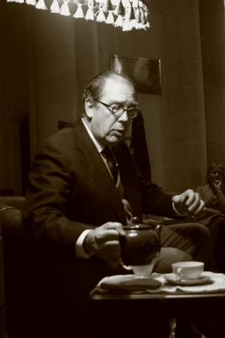 Philip Crowley as C.S. Lewis serves himself a cup of tea