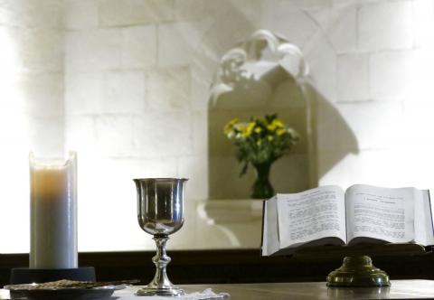 Candle, cup and bible