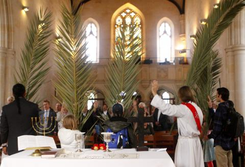 worshipers wave palms in church