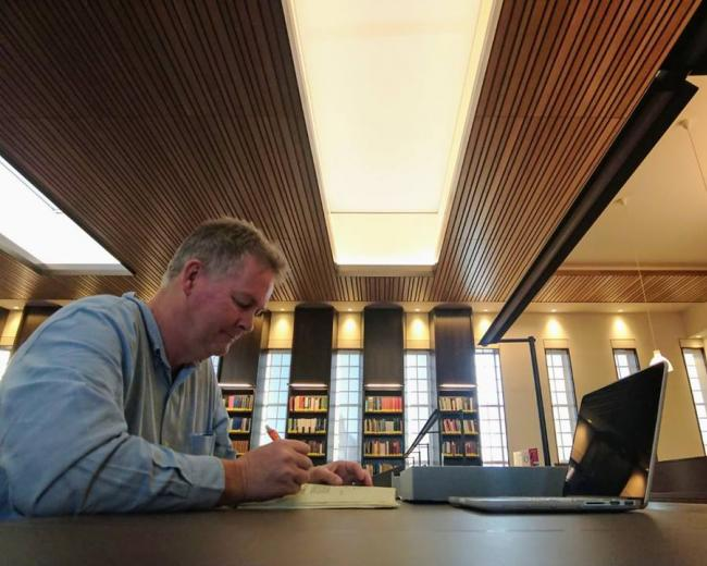 Dr Garth Gilmour studying at the Bodleian Library, Oxford