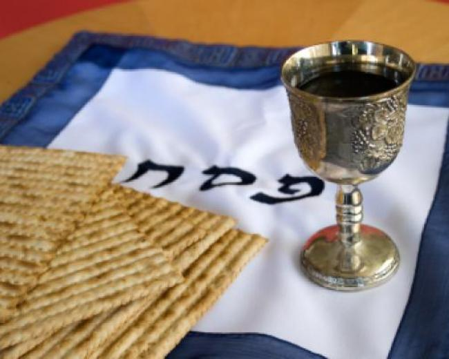 A Passover matzatash, Kiddush cup and matzah