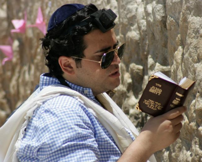 A Jewish man praying at the Western Wall, Jerusalem
