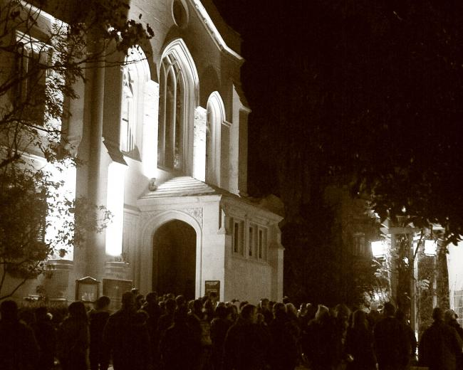Christ Church at night with crowd