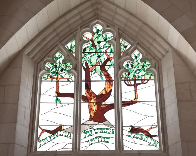 "The olive tree is taken from Paul's teaching on God's mercy to the Jewish people in Romans 11:11-36. The text in Hebrew quotes Romans 11:32: ""For God has consigned all to disobedience, that he may have mercy on all."" Stained glass by Rick Wienicke."